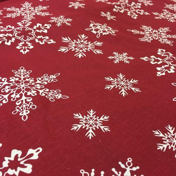 ткань со снежинками красная